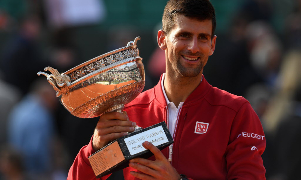 PARIS, FRANCE - JUNE 05:  Champion Novak Djokovic of Serbia poses with the trophy following his victory during the Men's Singles final match against Andy Murray of Great Britain on day fifteen of the 2016 French Open at Roland Garros on June 5, 2016 in Paris, France.  (Photo by Dennis Grombkowski/Getty Images) ORG XMIT: 631081511 ORIG FILE ID: 538276240