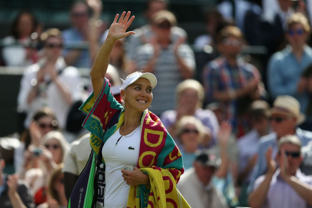 Russia's Elena Vesnina waves after beating Slovakia's Dominika Cibulkova in their women's singles quarter-final match on the ninth day of the 2016 Wimbledon Championships at The All England Lawn Tennis Club in Wimbledon, southwest London, on July 5, 2016. / AFP PHOTO / JUSTIN TALLIS / RESTRICTED TO EDITORIAL USEJUSTIN TALLIS/AFP/Getty Images ORIG FILE ID: 553732521
