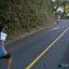 Spectator wildly chases after cyclists