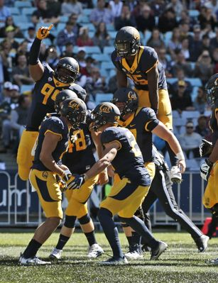 Cal routs Hawaii in college opener from Australia