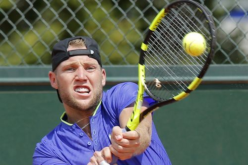 The Latest: Vesely upsets Sock at French Open